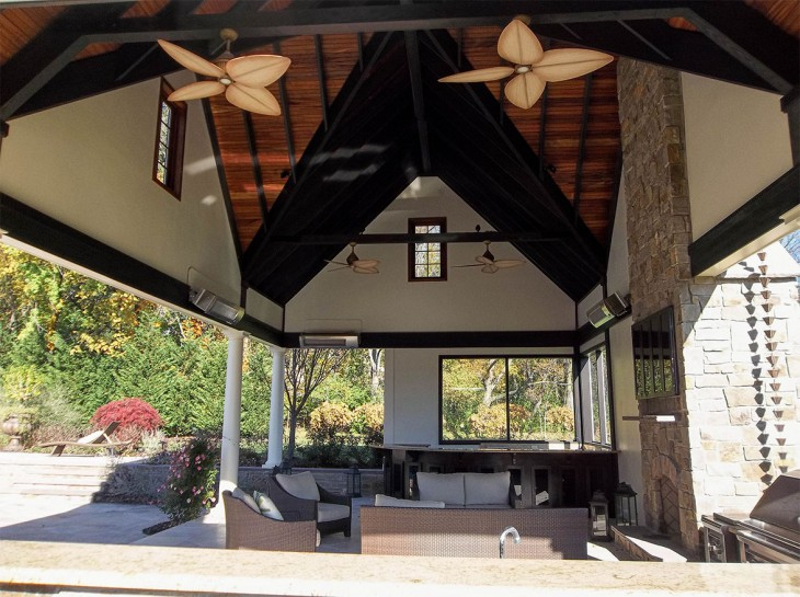 Outdoor Living Space with large ceiling and fans