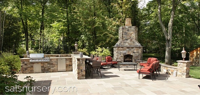 Outdoor Kitchen with seating and outdoor fireplace