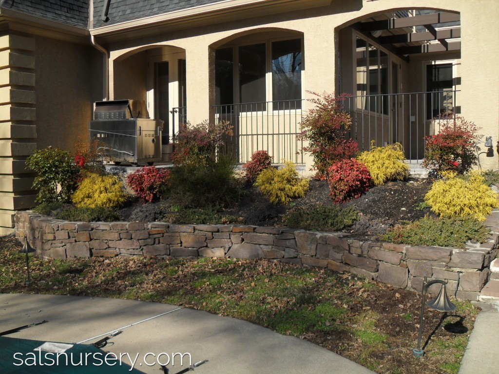 Before image of landscaping and retaining wall