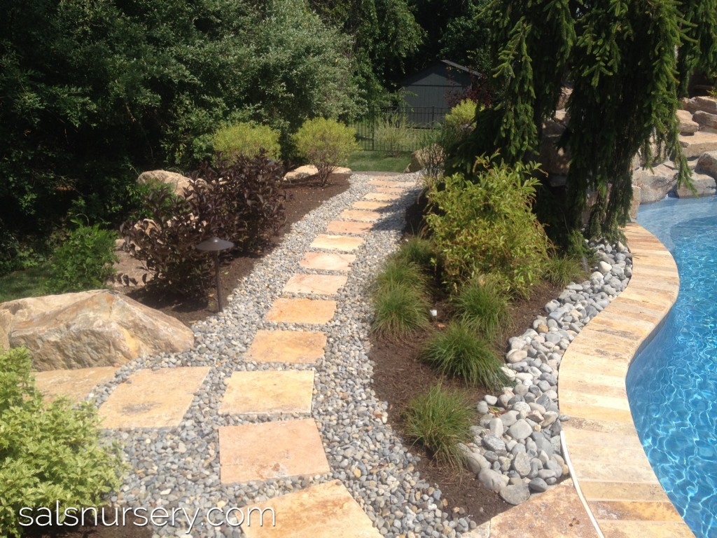 Outdoor pathway with gravel and pavers