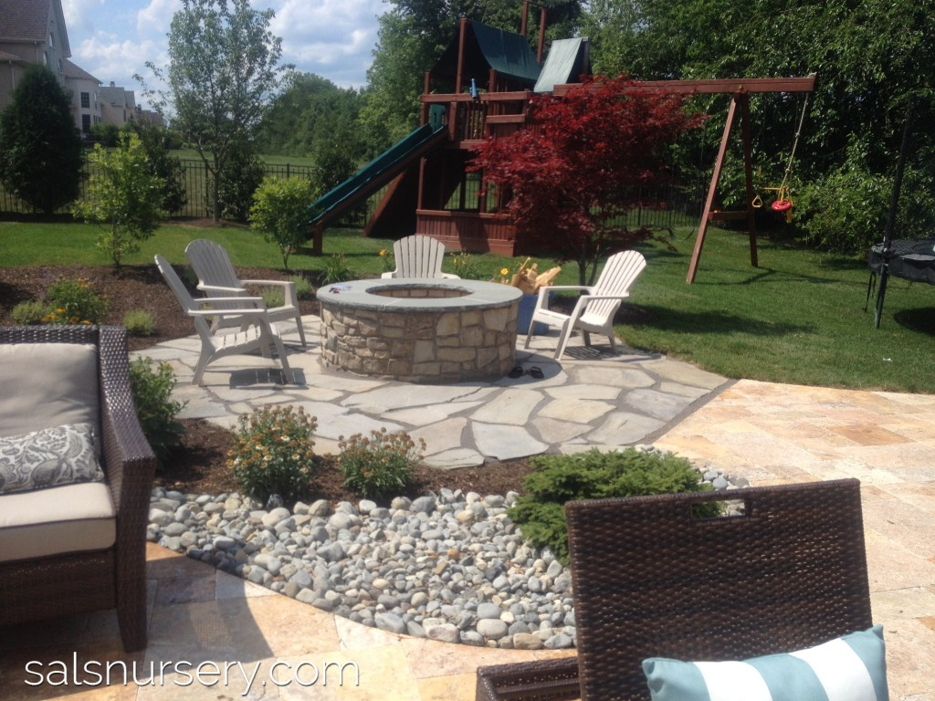 Fire Pit with surrounding patio and chairs