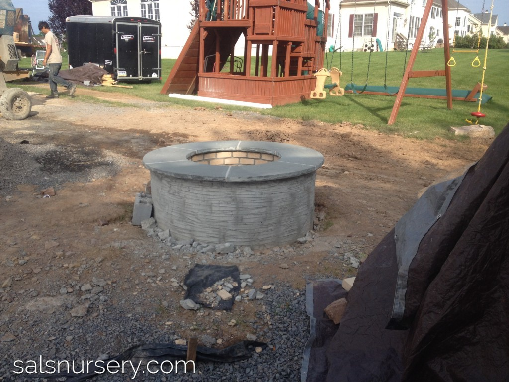 Construction of an outdoor fire pit and patio