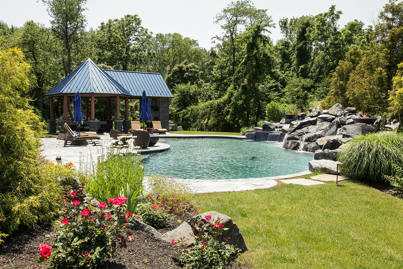 Pool With Large Boulder Creating A Very Natural Feel